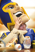 Kiara Tomasello, hospitality sophomore and theatre arts minor, takes a break inside the Sammy Spartan mascot, during the filming of Sammy Spartan Graduates at Dr. Martin Luther King, Jr. Library in San Jose, California, on May 2, 2013. (Stan Olszewski/SOSKIphoto)