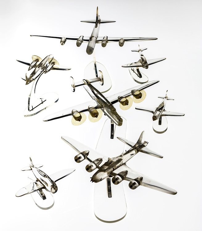 Always good with his hands, SSG Harvey Brundage carved these aircraft models from broken pieces of bomber windshields.