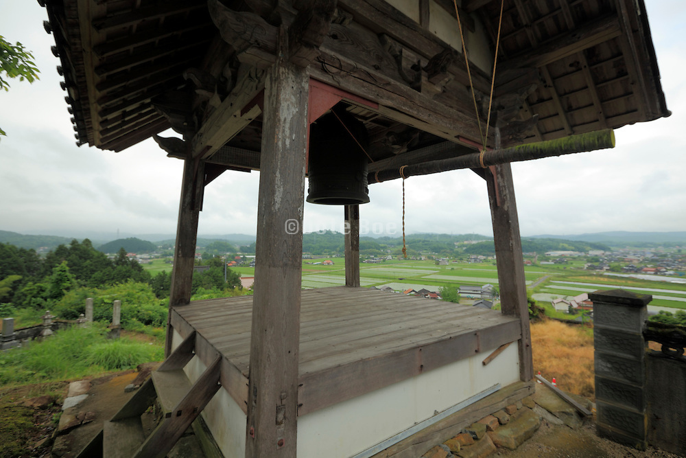 bell tower in rural landscape Japan