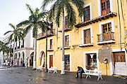 People relax along the Plaza de las Armas and the Portales de Veracruz in the historic center of the city of Veracruz, Mexico. The area is the main public square in Veracruz.
