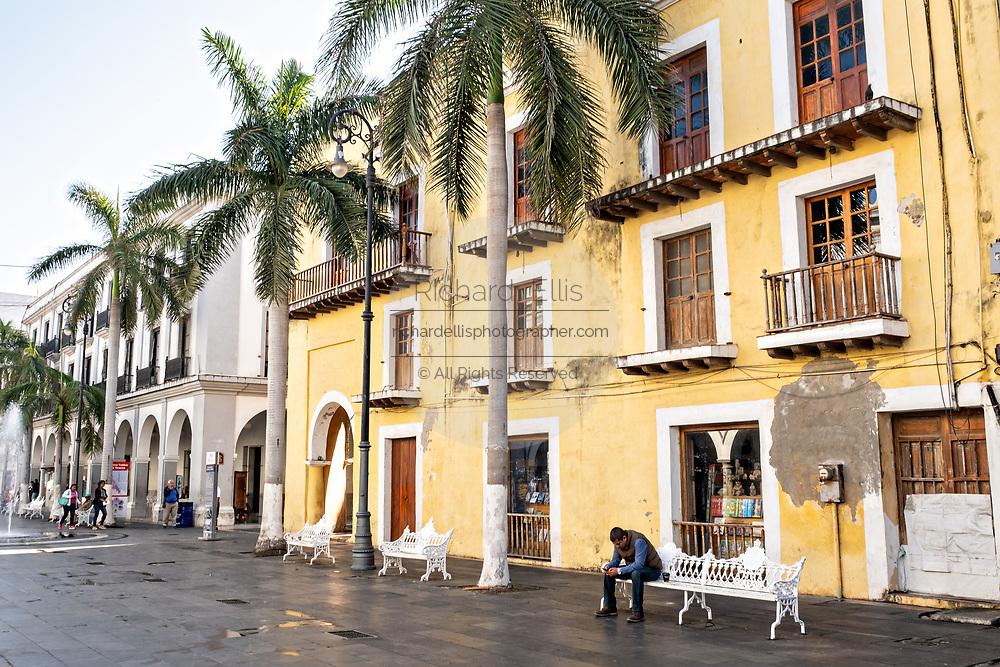 People relax along the Plaza de las Armas and the Portales de Veracruz in the historic center of the city of Veracruz, Mexico. The area is the main public square in Veracruz.