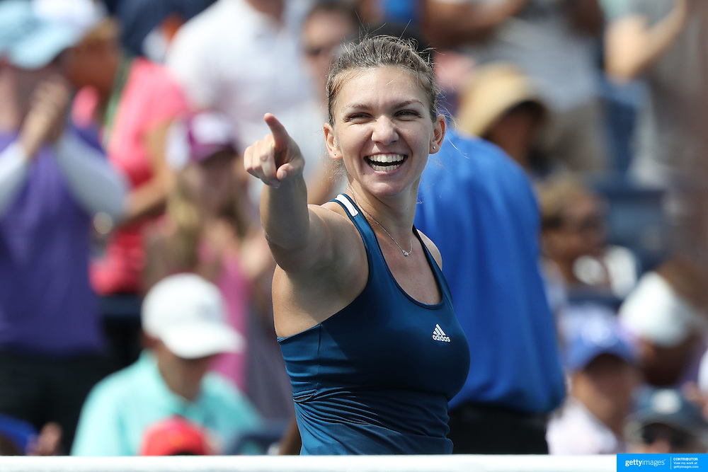 2016 U.S. Open - Day 8  Simona Halep of Romania celebrates victory against Carla Suárez Navarro of Spain in the Women's Singles round four match on Arthur Ashe Stadium on day six of the 2016 US Open Tennis Tournament at the USTA Billie Jean King National Tennis Center on September 5, 2016 in Flushing, Queens, New York City.  (Photo by Tim Clayton/Corbis via Getty Images)