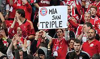 "Fotball<br /> Tyskland<br /> 01.06.2013<br /> Foto: Witters/Digitalsport<br /> NORWAY ONLY<br /> <br /> Fans Bayern mit Plakat ""Mia san Triple""<br /> <br /> Fussball, DFB-Pokal-Finale 2013, FC Bayern München - VfB Stuttgart"