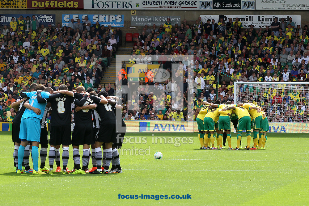 Both teams in the pre match huddle before the Sky Bet Championship match at Carrow Road, Norwich<br /> Picture by Paul Chesterton/Focus Images Ltd +44 7904 640267<br /> 16/08/2014