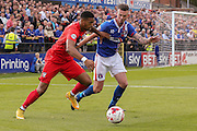 York City forward Vadaine Oliver and Carlisle United defender Michael Raynes in another battle  during the Sky Bet League 2 match between York City and Carlisle United at Bootham Crescent, York, England on 19 September 2015. Photo by Simon Davies.