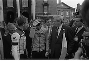 Nissan International Cycle Race..1986..01.10.1986..10.01.1986..1st October 1986..The Nissan Classic began today from Trinity College,Dublin. The offical race starter was The Taoiseach,Dr Garrett FitzGerald TD. He was accompanied by the Minister for Sport,Mr Sean Barrett TD..Sean Kelly was returning to defend his title but his opposition included Greg LeMond, the 1983 world champion and the winner of the Tour de France of the previous July. Roche was out due to his injured leg. Adri van der Poel was back with 1980 Tour de France winner and 1985 world champion Joop Zoetemelk. Teun van Vliet was back too. The winner of the green jersey of the Tour de France that July, Eric Vanderaerden was there as well as Australians Phil Anderson and Alan Peiper as well the Scottish cyclist Robert Millar...Photograph of Greg Lemond,La Vie Claire Team, Sean Kelly,Guinness Kas Team,An Taoiseach,Garret Fitzgerald and Mr Gerard O'Toole, M.D.Nissan Ireland on the start podium.