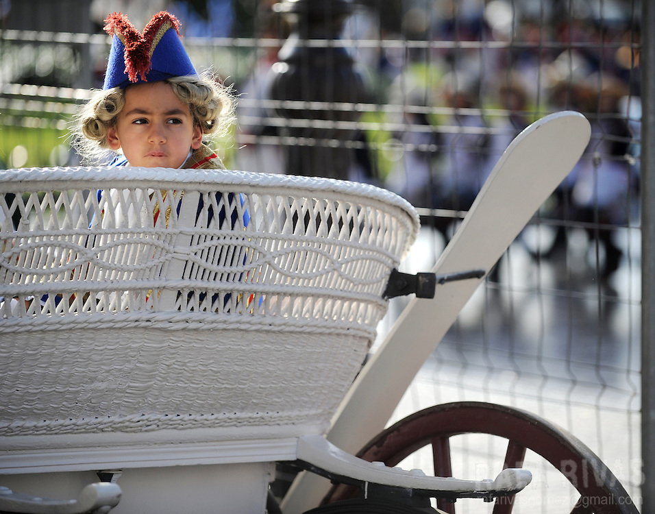 One child sits on a carriage as he takes part in San Sebastian's Tamborrada. Some thousands soldiers-clad children march and play drums, on January 20, 2010, during a parade to celebrate San Sebastian's day, the northern Spanish Basque city of San Sebastian's main feast. PHOTO / RAFA RIVAS