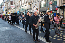London, UK. 17 September, 2019. Climate activists from Extinction Rebellion stage a RIP London Fashion Week Funeral March to call on both the public and the fashion industry to demand an end to London Fashion Week and the unsustainable system of consumption which it promotes. The event included a pause to reflect on the lives already lost and those that will be lost as a result of the climate and ecological crisis. Credit: Mark Kerrison/Alamy Live News