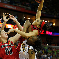 April 7, 2013; New Orleans, LA, USA; Louisville Cardinals guard Bria Smith (top) grabs a rebound against California Golden Bears center Talia Caldwell (bottom, right) during the second half in the semifinals during the 2013 NCAA womens Final Four at the New Orleans Arena. Mandatory Credit: Derick E. Hingle-USA TODAY Sports