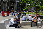 Lunchtime crowds eat takeaways in summer sunshine in Leadenhall in the City of London, the capital's financial district (aka the Square Mile), on 10th July 2019, in London England.