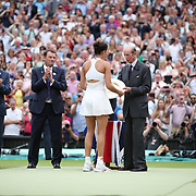 LONDON, ENGLAND - JULY 15:  Garbine Muguruza of Spain receives her winners trophy from Prince Edward, Duke of Kent after her victory against Venus Williams of The United States in the Wimbledon Lawn Tennis Championships at the All England Lawn Tennis and Croquet Club at Wimbledon on July 15, 2017 in London, England. (Photo by Tim Clayton/Corbis via Getty Images)