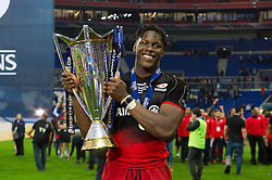 Maro Itoje of Saracens with the European Rugby Champions Cup trophy - Mandatory byline: Patrick Khachfe/JMP - 07966 386802 - 14/05/2016 - RUGBY UNION - Grand Stade de Lyon - Lyon, France - Saracens v Racing 92 - European Rugby Champions Cup Final.