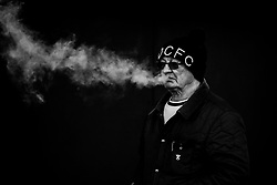 A Derby County fan smokes ahead of seeing his team take on Blackburn Rovers - Mandatory by-line: Robbie Stephenson/JMP - 08/03/2020 - FOOTBALL - Pride Park Stadium - Derby, England - Derby County v Blackburn Rovers - Sky Bet Championship
