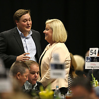 Fletcher Johnson, with BancorpSouth, talks with Jennifer Davis, Vice President of Merchandise, at the Community Development Foundation's 68th Annual Meeting and Report Thursday night at the BancorpSouth Arena in Tupelo.