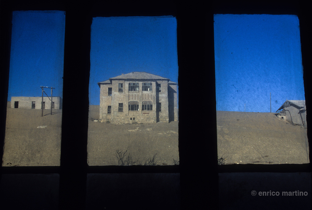 South Namibia. Kolmanskop, is a ghost town, a few kilometers inland from the harbour of Luderitz. It developed in 1908, after the discovery of diamonds in the area. The village was built like a German town. The town declined after WW1 and was abandoned in 1956. The desert mean that tourists can now walk through houses knee-deep in sand.