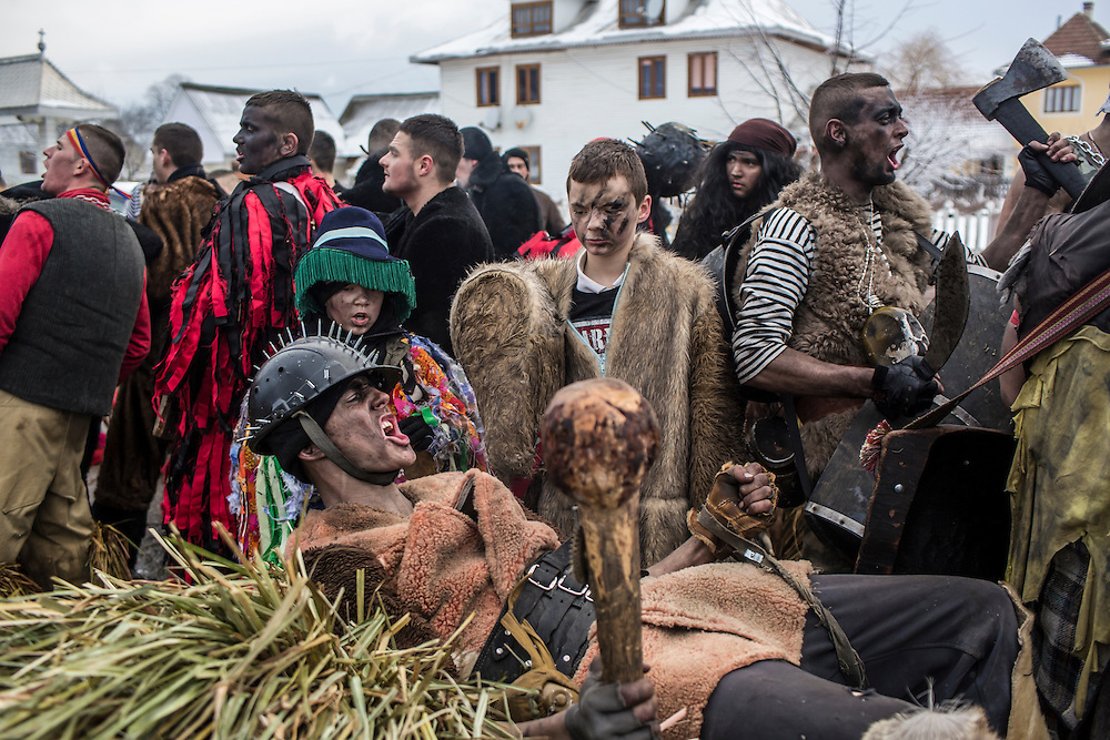 Ivan Morarash, 22, wearing a gypsy costume, celebrate the Malanka Festival on Thursday, January 14, 2016 in Krasnoilsk, Ukraine. The annual celebrations, which consist of costumed villagers going in a group from house to house singing, playing music, and performing skits, began the previous sundown, went all night, and will last until evening.