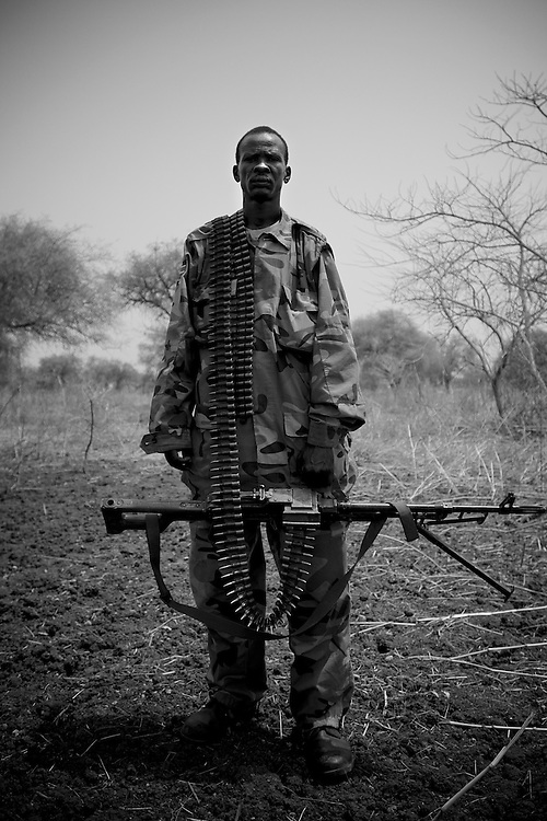 A SPLA soldier stands for a portrait at the frontline in South Sudan's Bentiu region during the conflict with the neighbouring Sudan over the control of oil fields in a disputed border area.