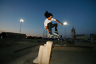 Emmanuel Guzman ollies over a chair. ..During the Santa Cruz Skateboards and Creature Skateboards team tour which made a stop at Louisville Extreme Park to film scenes for a new promotional video.