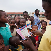 As part of the HCT programme in rural Makurdi EVA staff hand out their flyer advocating their My QandA service. My QandA is mobile phone text service run by EVA where young people can ask questions about sexual health anonymously. Benue state has got one of the highest HIV prevalence in Nigeria and EVA aim to target vulnerable children who would otherwise miss out of being tested for HIV and therefor not know their HIV statues.  Education As a Vaccine Against Aids (EVA) in Nigeria.Education As a Vaccine Against Aids (EVA) in Nigeria.