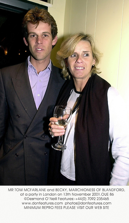 MR TOM MCFARLANE and BECKY, MARCHIONESS OF BLANDFORD, at a party in London on 13th November 2001.	OUE 86