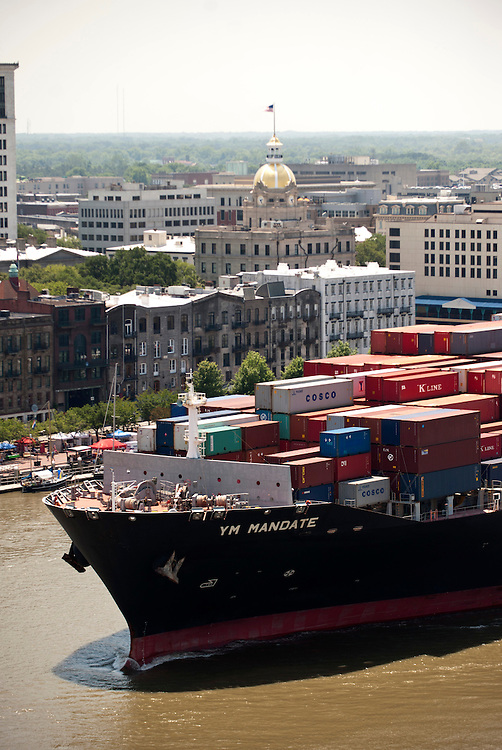 The Yang Ming Mandate sail downriver from the Georgia Ports Authority  Garden City Terminal past Historic River Street, Friday, May, 23, 2014, in Savannah, Ga.  (GPA Photo/Stephen B. Morton)