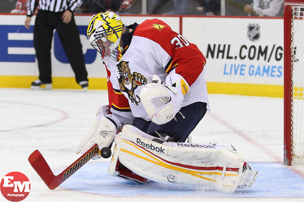 Mar 23, 2013; Newark, NJ, USA; Florida Panthers goalie Scott Clemmensen (30) makes a save during the third period at the Prudential Center. The Devils defeated the Panthers 2-1.