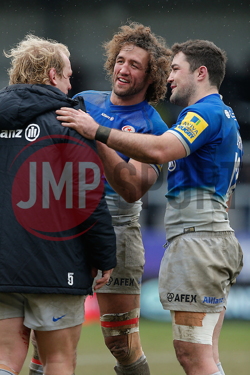 Saracens replacement Jacques Burger and Inside Centre Brad Barritt (capt) celebrate with Prop Petrus Du Plessis after their side win the match - Mandatory byline: Rogan Thomson/JMP - 07/02/2016 - RUGBY UNION - Sandy Park - Exeter, England - Exeter Chiefs v Saracens - Aviva Premiership.