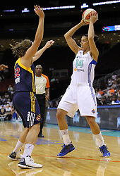 June 3, 2012; Newark, NJ, USA; New York Liberty forward Nicole Powell (14) looks to pass while being defended by Indiana Fever guard Jeanette Pohlen (32) during the first half at the Prudential Center.