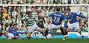 Celtic's Aiden McGeady takes on a trio of Rangers' players, left to right Lee McCulloch, Steven Whittaker and Steven Davis during the League Cup final between Rangers and Celtic at Hampden Park -<br /> David Young Universal News And Sport