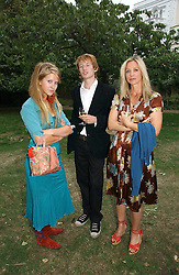 Left to right, FREYA WOOD, MATTHEW BELL and LADY LIZA CAMPBELL at a party to celebrate the publication of Notting Hell by Rachel Johnson held in the gardens of 1 Rosmead Road, London W11 on 4th September 2006.<br />