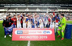 Milton Keynes Dons players and staff celebrate winning promotion to Sky Bet League One in the dressing room  - Mandatory by-line: Joe Meredith/JMP - 04/05/2019 - FOOTBALL - Stadium MK - Milton Keynes, England - Milton Keynes Dons v Mansfield Town - Sky Bet League Two