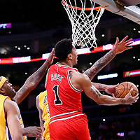 29 January 2015: Chicago Bulls guard Derrick Rose (1) goes for the reverse lay up past Los Angeles Lakers guard Jordan Clarkson (6) Los Angeles Lakers center Jordan Hill (27) and Los Angeles Lakers center Robert Sacre (50) during the Los Angeles Lakers 123-118 2OT victory over the Chicago Bulls, at the Staples Center, Los Angeles, California, USA.
