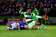 Tranmere Rovers defender Steve McNulty (5) brings down Forest Green Rovers midfielder Tahvon Campbell (14) for a penalty kick during the EFL Sky Bet League 2 match between Forest Green Rovers and Tranmere Rovers at the New Lawn, Forest Green, United Kingdom on 23 October 2018.