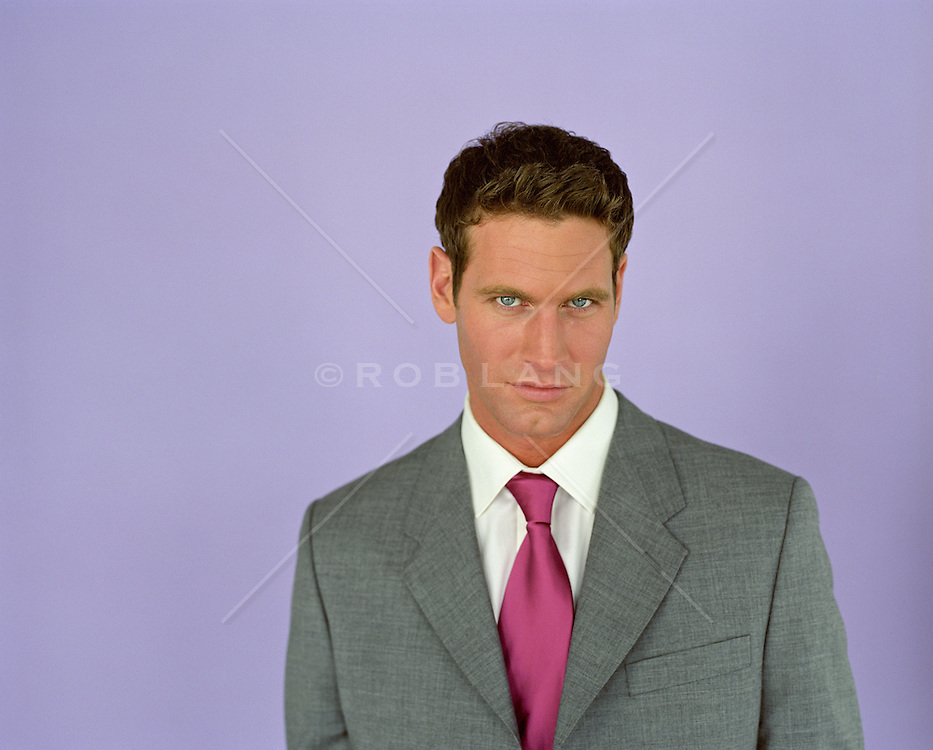 man in a suit and tie looking at camera