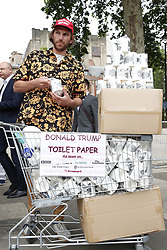 © Licensed to London News Pictures. 04/06/2019. London, UK. Toilet paper bearing the face of US President Donald Trump is sold in Parliament Square. On the 2nd day of President Trump's State Visit to the UK he is meeting outgoing Prime Minister Theresa May before attending 75th Anniversary of D-Day commemorations in Portsmouth and France tomorrow. Photo credit: Peter Macdiarmid/LNP