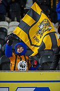 A Young Hull City fan waves a Hull City flag prior to kick off during the EFL Sky Bet Championship match between Hull City and Barnsley at the KCOM Stadium, Kingston upon Hull, England on 27 February 2018. Picture by Craig Zadoroznyj.