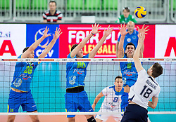 Gregor Ropret of Slovenia, Uros Pavlovic of Slovenia and Alen Sket of Slovenia vs Hermans Egleskalns of Lativa during volleyball match between National teams of Slovenia and Latvia in Qualifications for 2015 CEV Volleyball European Championship - Men on May 25, 2014 in Arena Stozice, Ljubljana, Slovenia. Photo by Vid Ponikvar / Sportida
