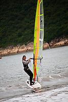 Windsurfing in the calm waters off Songlanshan beach in zhejiang province, china.