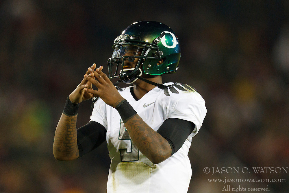 Nov 12, 2011; Stanford CA, USA;  Oregon Ducks quarterback Darron Thomas (5) signals to the sidelines before a play against the Stanford Cardinal during the fourth quarter at Stanford Stadium.  Oregon defeated Stanford 53-30. Mandatory Credit: Jason O. Watson-US PRESSWIRE