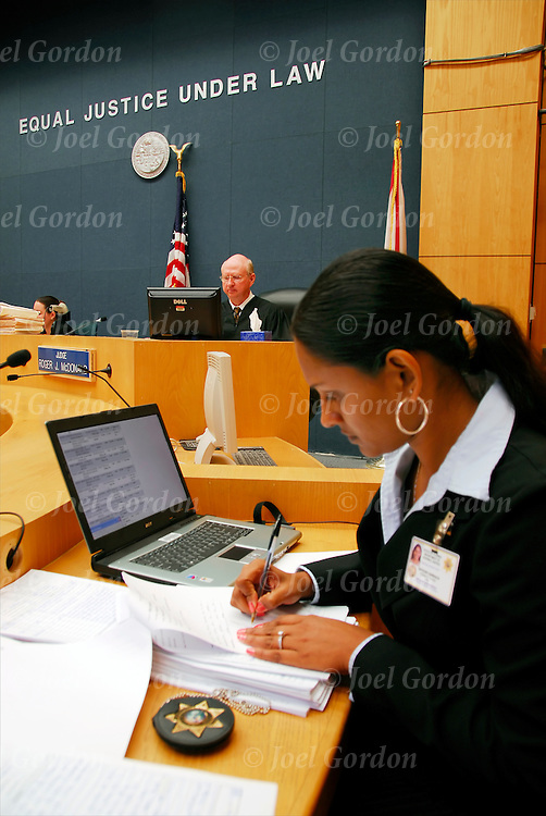 Judge in background, Asain American female probation officer making notes in Juvenile Justice Center, Ninth Judicial Circuit Court of Florida in Orlando FL