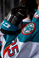 KELOWNA, CANADA - JANUARY 16: Kyle Crosbie #25 of the Kelowna Rockets stands on the bench against the Moose Jaw Warriors  on January 16, 2019 at Prospera Place in Kelowna, British Columbia, Canada.  (Photo by Marissa Baecker/Shoot the Breeze)