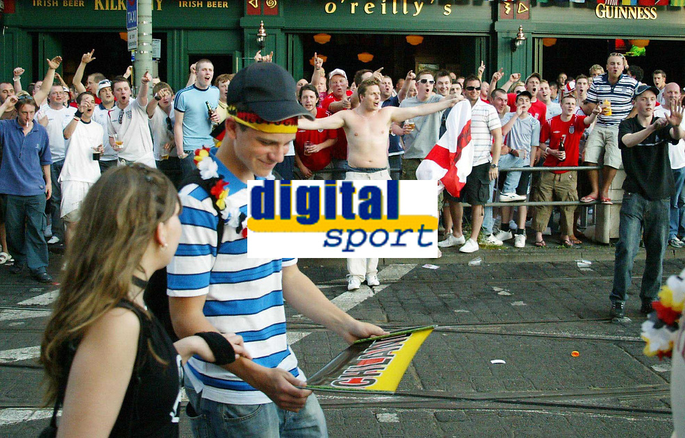 Photo: Chris Ratcliffe.<br /> England v Paraguay. Group B, FIFA World Cup 2006. 10/06/2006.<br /> England Fans get in the mood for the game as German fans pass by in Frankfurt.