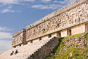 Archeologists Cleaning  Steps to The Palace of the Governor, Uxmal Maya Ruins,  Mexico 2007