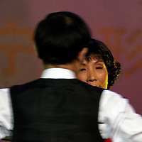 "BEIJING, 18 DECEMBER 2004: Liu Yulan, 62, the oldest participant of the ""first worldwide artificial beauty pageant "" ,shows her ballroom dancing skills in a theatre in Beijing, 18 December , 2003, in China...Beauty business in China , from cosmetic surgeries to hair brush sales, has amounted to more than USD 7 billion in 2003. The contest for women who have undetgone plastic surgery was organized after Yang Yuan, a young would-be model, was disqualified earlier on this year when organizers discovered that she'd had plastic surgery. Yang was present during the contest to introduce her biography that explains why she has the right to ""improve"" her natural features... .."