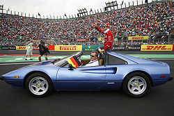 October 29, 2017 - Mexico City, Mexico - Pole sitter SEBASTIAN VETTEL (Scuderia Ferrari) waves to the crowd during the drivers parade before the FIA Formula One Grand Prix of Mexico. (Credit Image: © Hoch Zwei via ZUMA Wire)