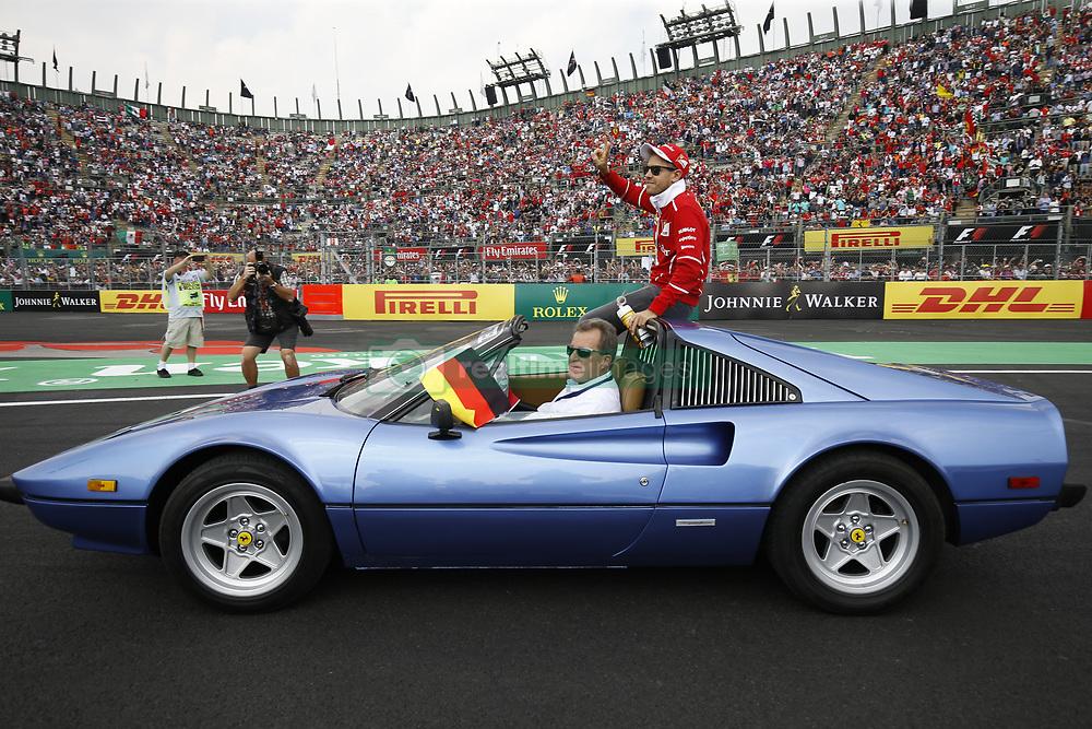 October 29, 2017 - Mexico City, Mexico - Pole sitter SEBASTIAN VETTEL (Scuderia Ferrari) waves to the crowd during the drivers parade before the FIA Formula One Grand Prix of Mexico. (Credit Image: © Hoch Zwei via ZUMA Wire)