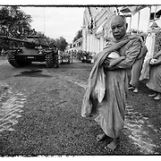 Thai Buddhist monks gather to collect alms the morning after a coup outsted Prime Minster Taksin Shinawatra.