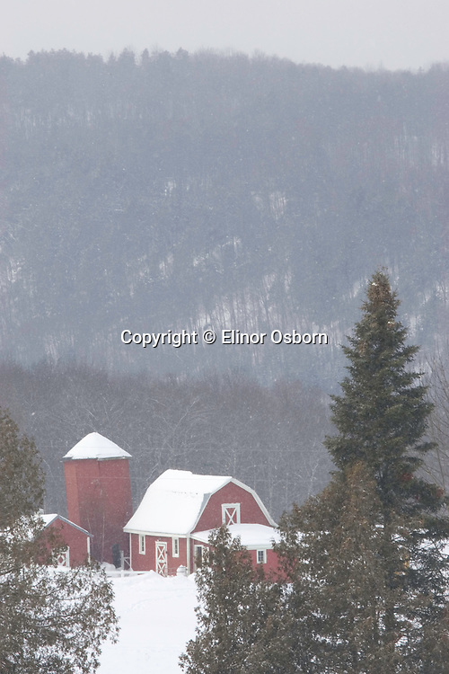Barn in falling snow