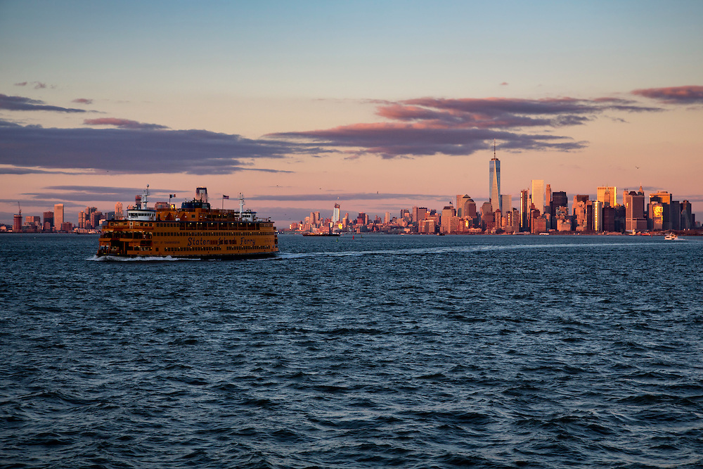 A Staten Island Ferry sails across the Upper Bay at sunset away from Lower Manhattan, also know as Downtown Manhattan which is the financial district and centre for business, culture and government in the city of New York, United States of America. (photo by Andrew Aitchison / In pictures via Getty Images)