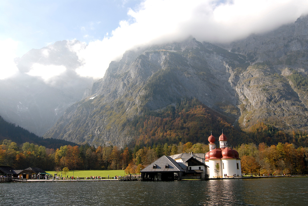 The very famous St. Bartholomä church on the  Königssee in the background the Watzman, Berchtesgadener land National park, Bavaria, Germany
